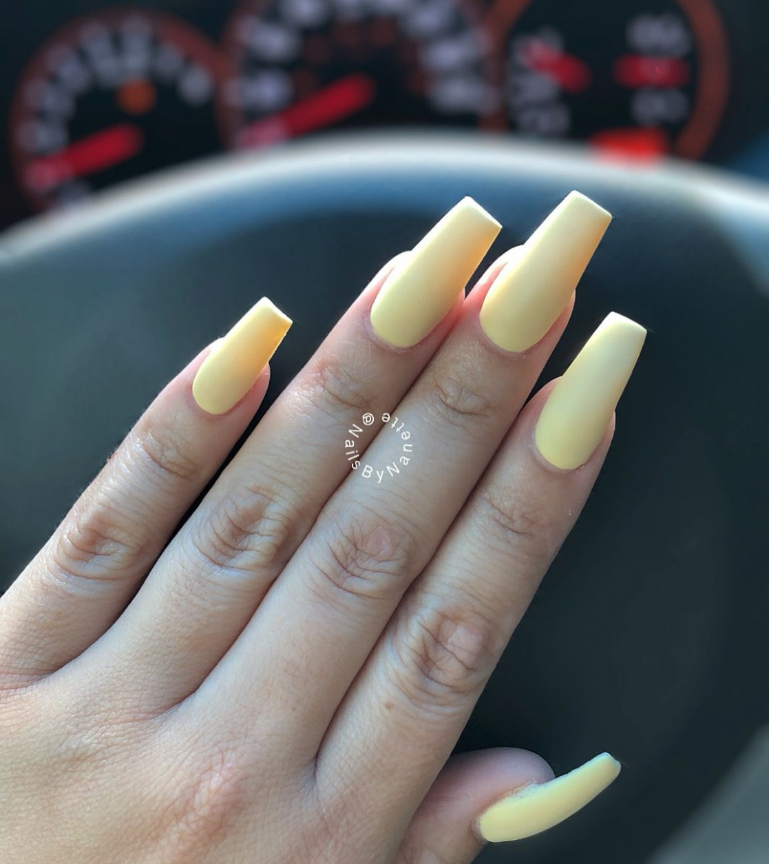 Pastel yellow matted coffin or ballerina nails in medium length