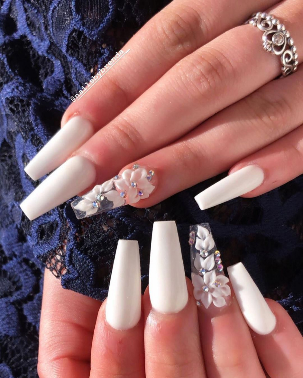 Cute white coffin nails design with accent floral nail